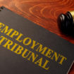 Book with title employment tribunal on a table.