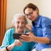 Senior woman with female caregiver