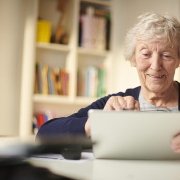 senior woman using the web to keep in touch