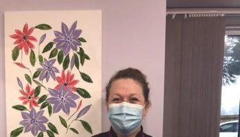 Sarah with Paintings